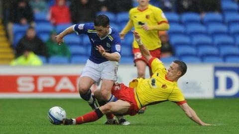 Craig Conway is challenged by Jonathan Hogg