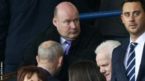 Ellis takes his seat at Ibrox after becoming a non-executive director