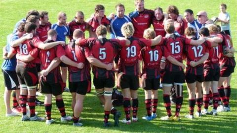 Jersey team huddle