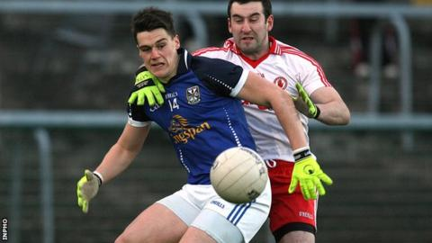 Cavan's Kevin Tierney is challenged by Tyrone's Dean McNally