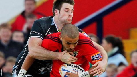 Johnnie Beattie tackles Simon Zebo at Musgrave Park