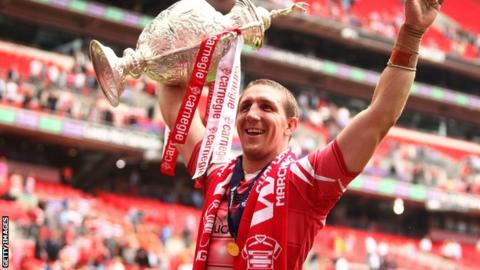 Ryan Hoffman of Wigan Warriors celebrates by lifting the Carnegie Cup