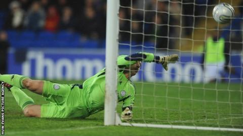 Derby keeper Frank Fielding is unable to stop Mark Hudson's goal for Cardiff