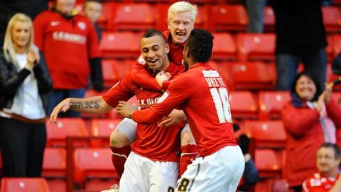 Barnsley's Craig Davies celebrates with team-mates David Perkins and Ricardo Vaz Te after scoring against Bristol City.