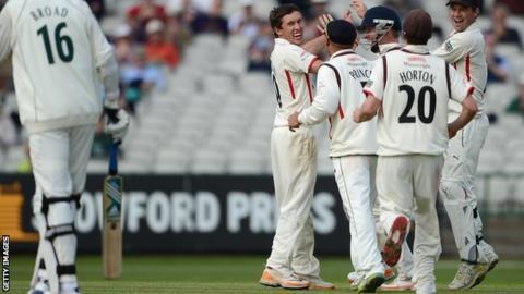 Lancashire celebrate the wicket of Stuart Broad