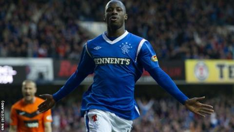 Aluko celebrates after scoring twice within three first-half minutes