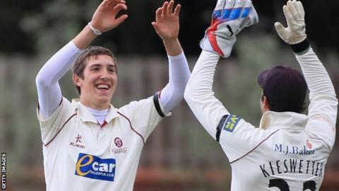 Craig Overton celebrates a wicket