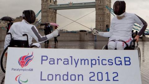 Wheelchair fencers in front of Tower Bridge in London