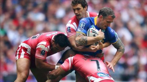 Jamie Peacock for Leeds battles with the Wigan pack