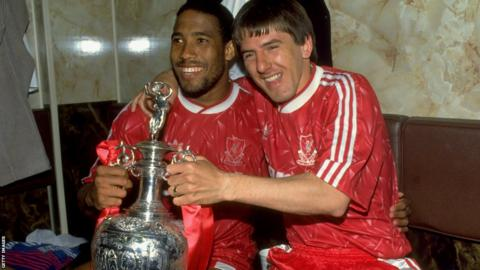 John Barnes (left) and Peter Beardsley (right)
