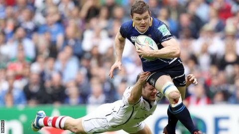 Brian O'Driscoll tries to burst away from Darren Cave's tackle at Twickenham