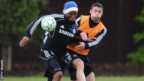 Gary Cahill (right) takes on Didier Drogba in training