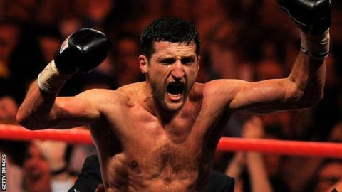 Carl Froch celebrates beating Lucian Bute