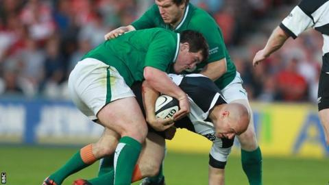 Irish pair Declan Fitzpatrick and Mike Sherry tackle Felipe Contepomi