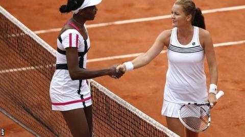 Venus Williams (left) congratulates Agnieszka Radwanska on her victory