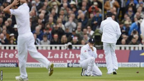 Graham Onions (left) reacts after teammate Ian Bell (centre) dropped a catch from the bat of West Indies' Adrian Barath