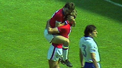 Bryan Robson celebrates his opening goal against France at 1982 World Cup