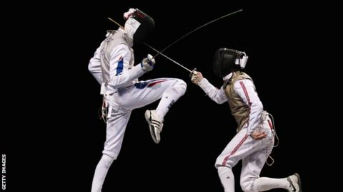 Keith Cook (right) in action for Great Britain against Brice Guyart of France.