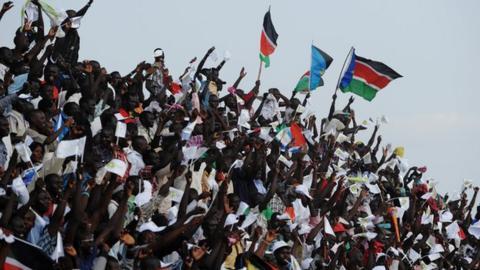 South Sudan football fans waving flags