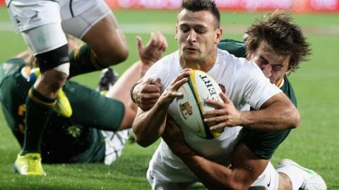 Danny Care dives over to score a try for England