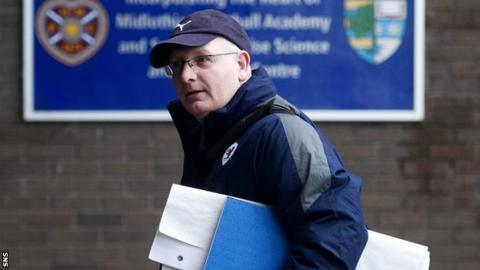 John McGlynn enters Tynecastle for talks