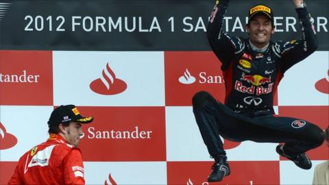 Mark Webber celebrates victory at Silverstone