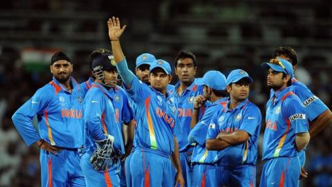 Indian cricket team await the decision of an umpire review