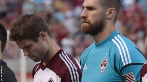 Colorado Rapids' Drew Moor and Matt Pickens pause for a moment of silence in honour of the shooting victims in Aurora, Colorado before a game against Real Salt Lake on Saturday, 21 July 2012 at Rio Tinto Stadium in Sandy, Utah