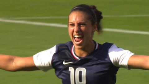 Carli Lloyd celebrates scoring against France