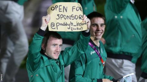 Paddy Barnes holds aloft his sign at the Olympics Opening Ceremony