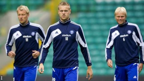 Juho Makela (centre) trains at Celtic Park