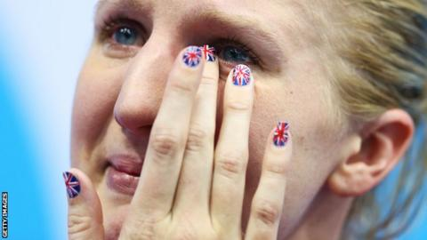 Becky Adlington sheds a tear as she prepares to collect her bronze in the 800m freestyle