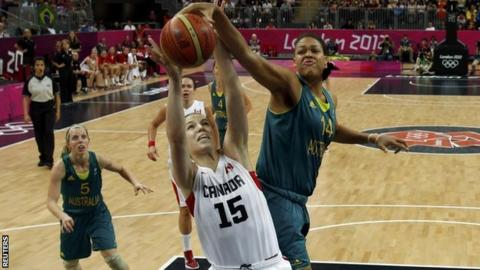 Australia's Liz Cambage tries to stop Canada's Michelle Plouffe