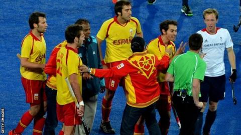 Spain's players argue with the umpire
