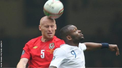 James Collins challenges England's Darren Bent in his last game for Wales in March 2011
