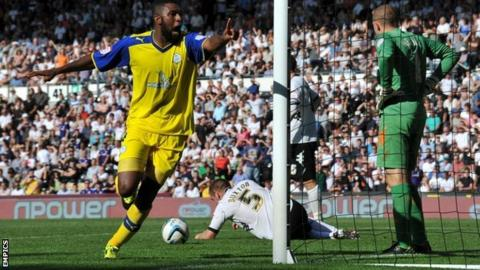 Reda Johnson celebrates scoring Sheffield Wednesday's equaliser at Derby
