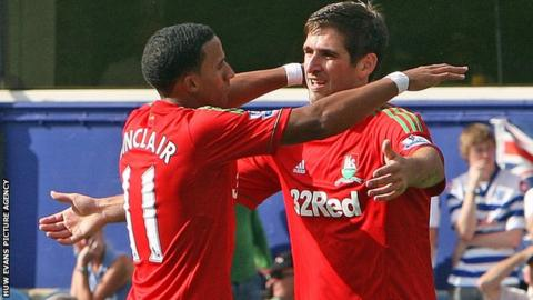 Scott Sinclair celebrates his goal against QPR with Danny Graham