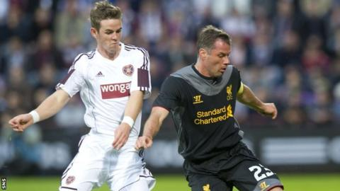 Hearts' David Templeton tussles with Liverpool defender Jamie Carragher