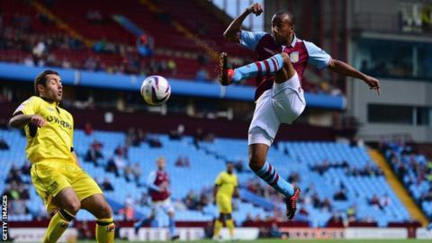 Aston Villa's Fabian Delph [r]