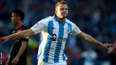 Jordan Rhodes in action for Huddersfield