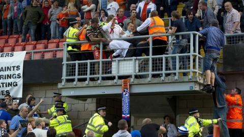 Police and stewards intervene as fans battle at Tannadice