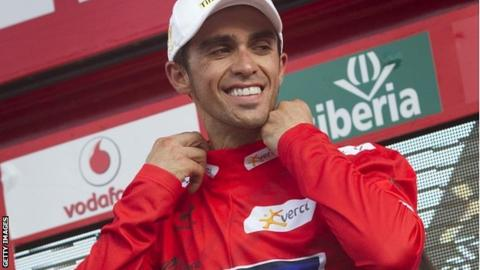 Alberto Contador slips on the leader's red jersey for the third day in a row