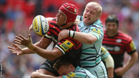 Mouritz Botha of Saracens is tackled by Leicester's Dan Cole and Sam Harrison