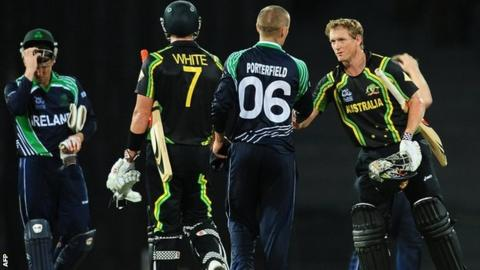 William Porterfield congratulates Australia captain George Bailey at the end of the match