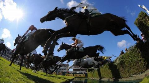 Unowatimeen ridden by Samantha Drake jumps the water jump during the Fox Hunters Steeple chase