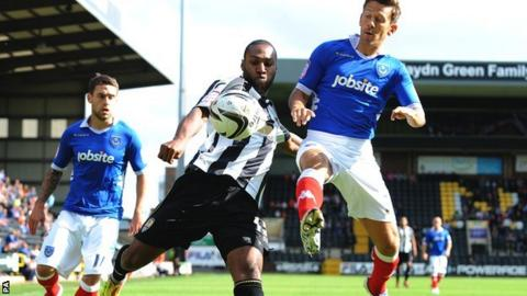 Yoann Arquin (left) is challenged by Portsmouth's Jon Harley