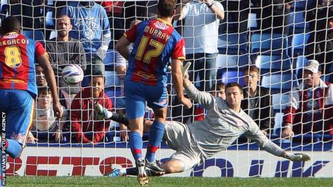 Glenn Murray scores Palace's third from the penalty spot.