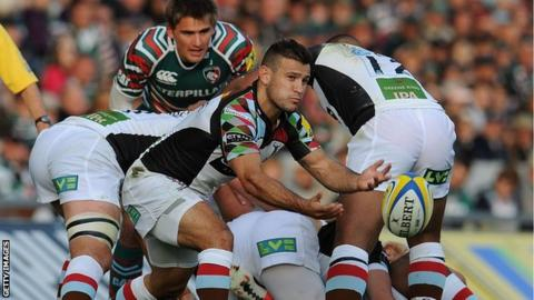 Danny Care moved the ball from a ruck as Toby Flood looks on