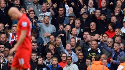 Liverpool's Jonjo Shelvey is sent off after a tackle on Manchester United's Jonny Evans