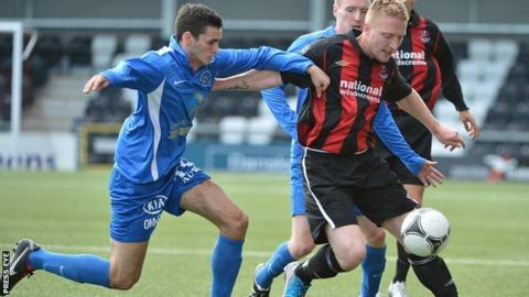 Ballinamallard's Stuart Hutchinson in action against Chris Morrow of Crusaders